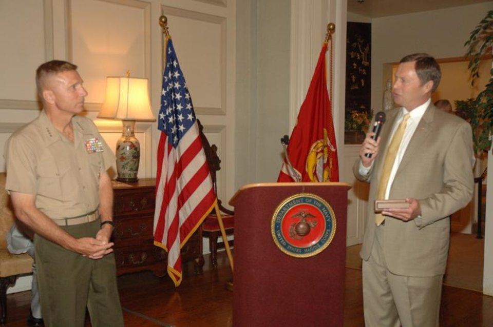Phil E. Hughes, President of the US Marine Corps Coordinating Council of Oklahoma and a Norman resident, presents a memento to the Commandant of the Marine Corps, General Michael W. Hagee USMC at a reception for the Commandant of the Marine Corps on July 27, 2006 at the Oklahoma City Golf and Country Club<br/><b>Community Photo By:</b> Official USMC Photograph<br/><b>Submitted By:</b> Peter B., Midwest City