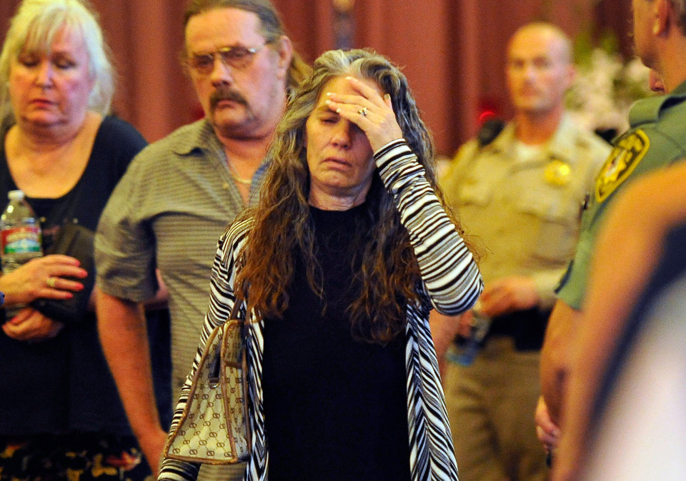 Photo - Debra Wilcox, mother of of Joseph Wilcox, exits the chapel after a memorial service for her son at Palm Downtown Mortuary on Sunday, June 22, 2014, in Las Vegas. Wilcox went for his own legal and concealed handgun after a couple killed Officers Igor Soldo and Alyn Beck at a nearby pizza shop and walked into a Wal-Mart, fired a shot in the air, and declared the start of a revolution two weeks ago. (AP Photo/Las Vegas Review-Journal, David Becker, Pool)