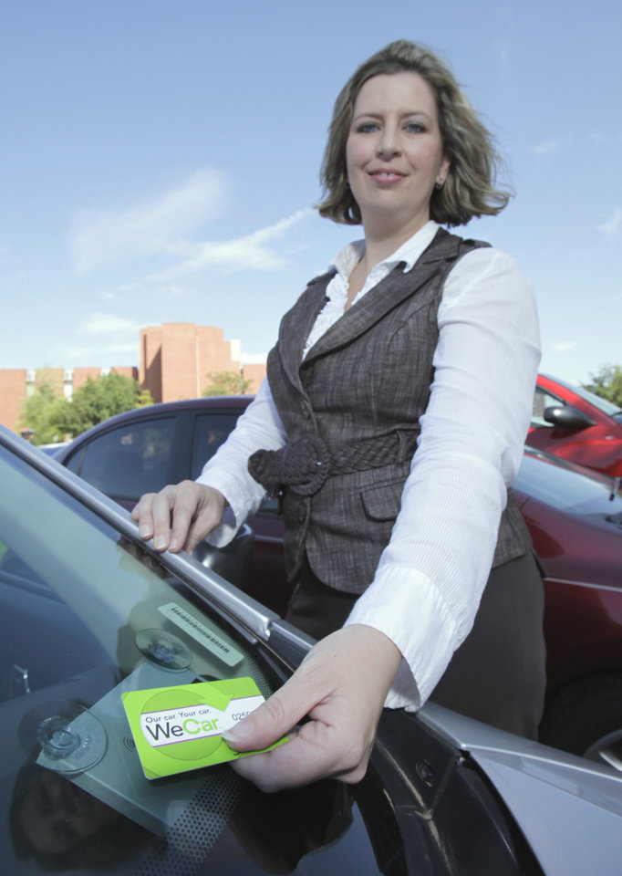Enterprise Rent-A-Car branch manager Jennifer Hardin shows the pass card system at the University of Oklahoma for the Wecar Rental cars on Tuesday, August 31, 2010, in Norman, Okla.  Photo by Steve Sisney, The Oklahoman