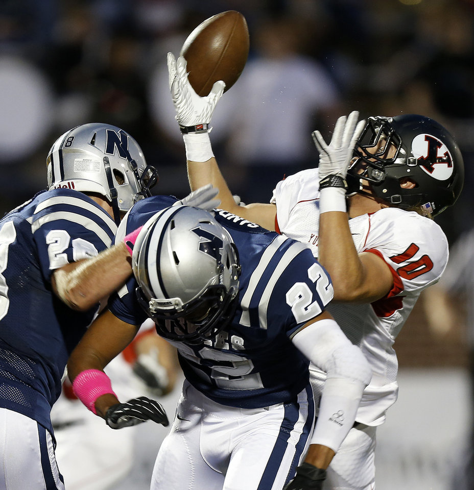 Photo - Yukon's Brandon Andraszek can't make the catch beside Edmond North's Jake Hobbs, left, and Dante Sanders during their high school football game at Wantland Stadium in Edmond, Okla., Thursday, October 4, 2012. Photo by Bryan Terry, The Oklahoman