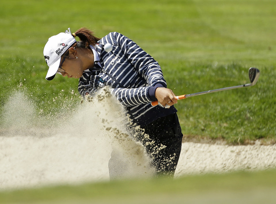 Photo - Lydia Ko, of New Zealand, hits out of a bunker up to the sixth green of the Lake Merced Golf Club during the third round of the Swinging Skirts LPGA Classic golf tournament on Saturday, April 26, 2014, in Daly City, Calif. (AP Photo/Eric Risberg)
