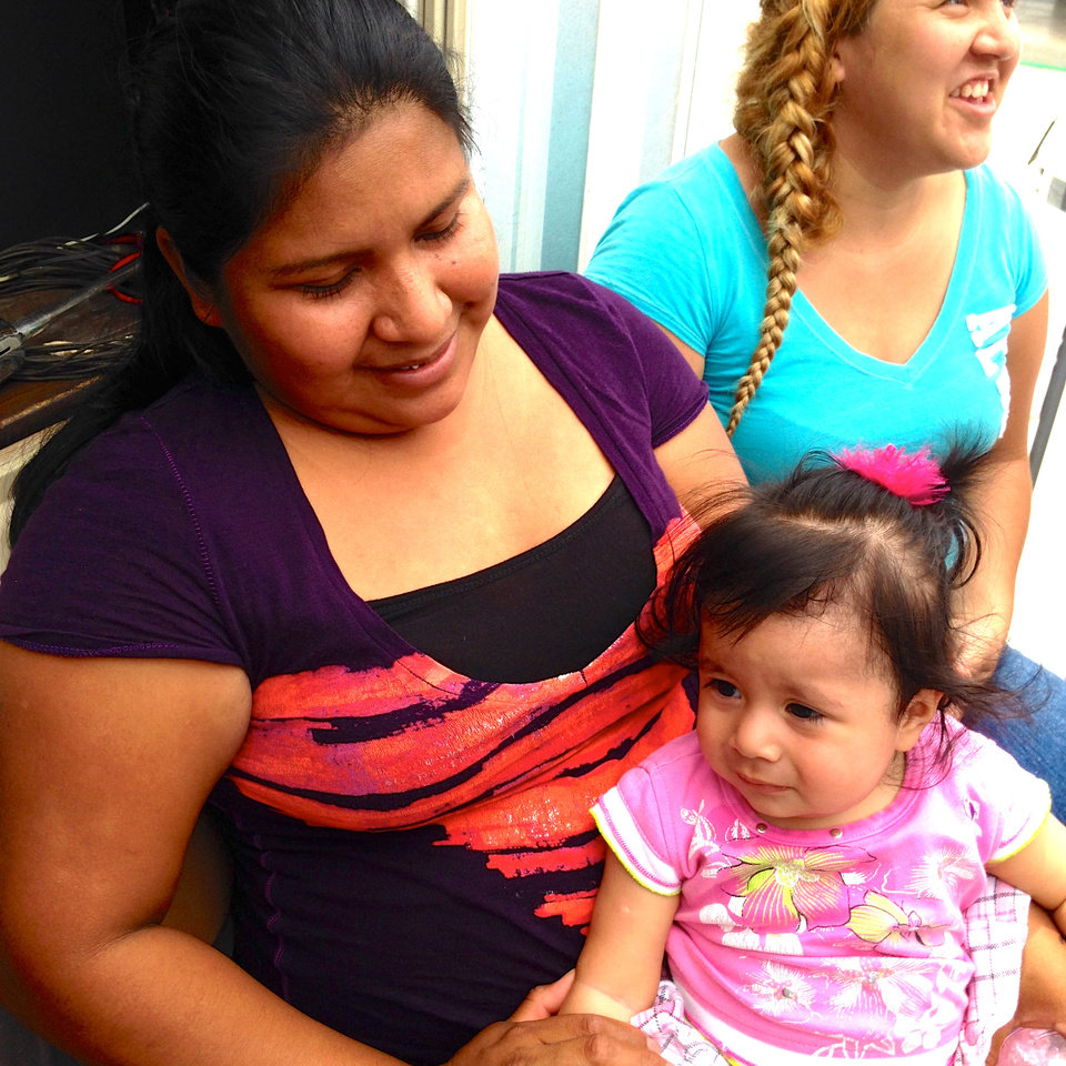 Photo -  Most of the immigrants flooding the border between the U.S. and Mexico are women and children, such as this mother being cared for by People Caring for People, an Oklahoma City nonprofit. Photo provided.