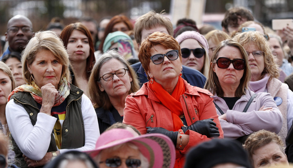 Photo -  March attendees listen to speakers Saturday at The Women's March on Oklahoma. [Photo by Jim Beckel, The Oklahoman]
