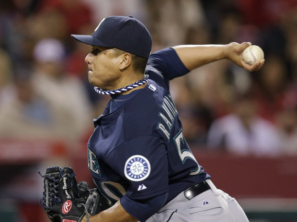 Photo - Seattle Mariners starting pitcher Erasmo Ramirez throws against the Los Angeles Angels during the second inning of an MLB American League  baseball game on Tuesday, April 1, 2014, in Anaheim, Calif. (AP Photo/Jae C. Hong)