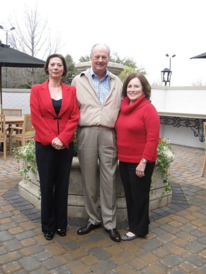 GOLF SHOP GRAND OPENING....Linda Dowling,Jim MacKellar and SoRelle Fitzgerald check out the new golf area. (Photo by Helen Ford Wallace).