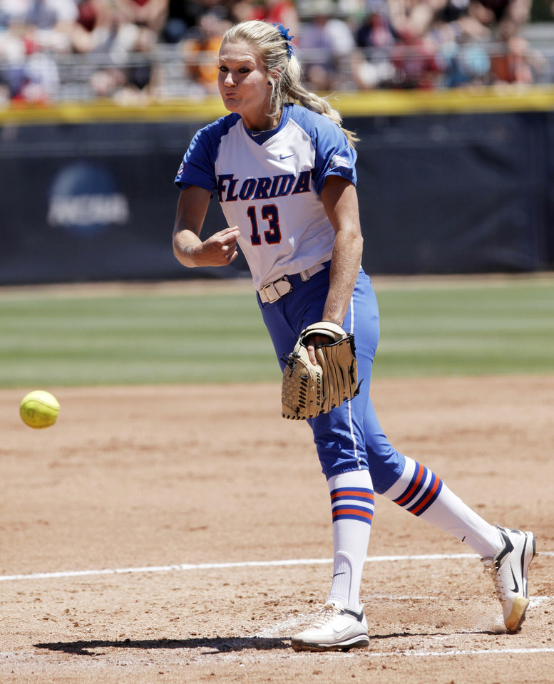 Photo - Florida pitcher Hannah Rogers throws a pitch in the Women's College World Series elimination game versus Texas. The Florida Gators would go on to lose 3-0. Photo by KT KING, The Oklahoman