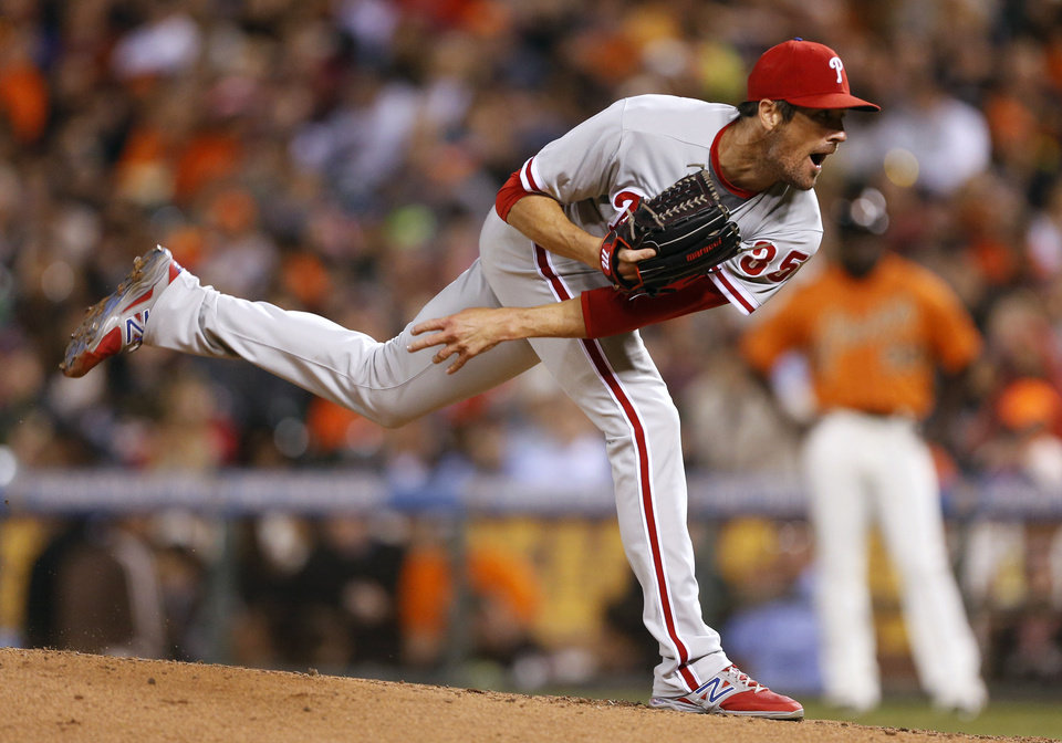 Photo - Philadelphia Phillies pitcher Cole Hamels watches a throw during the fourth inning of a baseball game against the San Francisco Giants, Friday, Aug. 15, 2014, in San Francisco. (AP Photo/Beck Diefenbach)