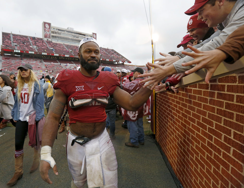 Photo - Oklahoma's Samaje Perine (32) celebrates with fans after the Bedlam college football game between the Oklahoma Sooners (OU) and the Oklahoma State Cowboys (OSU) at Gaylord Family - Oklahoma Memorial Stadium in Norman, Okla., Saturday, Dec. 3, 2016. Oklahoma won 38-20. Photo by Bryan Terry, The Oklahoman