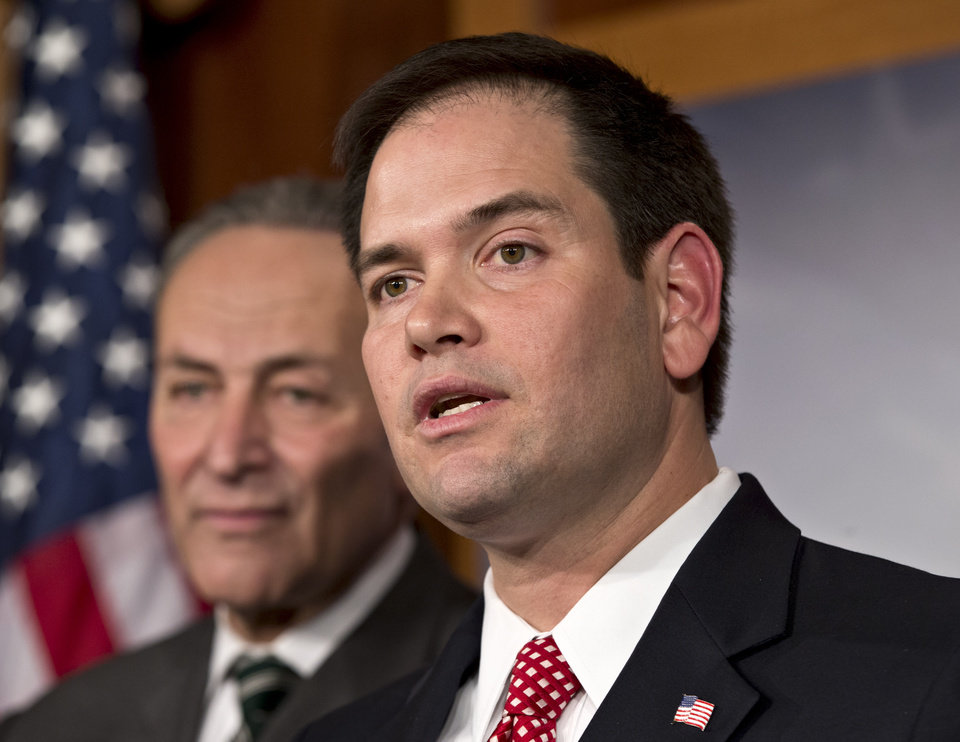 FILE - In this Jan. 28, 2013, photo, Sen. Marco Rubio, R-Fla., right, and Sen. Charles Schumer, D-N.Y., left, join a bipartisan group of leading senators to announce that they have reached agreement on the principles of sweeping legislation to rewrite the nation\'s immigration laws, during a news conference at the Capitol in Washington. Republicans face a delicate balancing act as they embrace immigration reform _ and no one is more symbolic of the potential risks and rewards than Rubio. (AP Photo/J. Scott Applewhite)