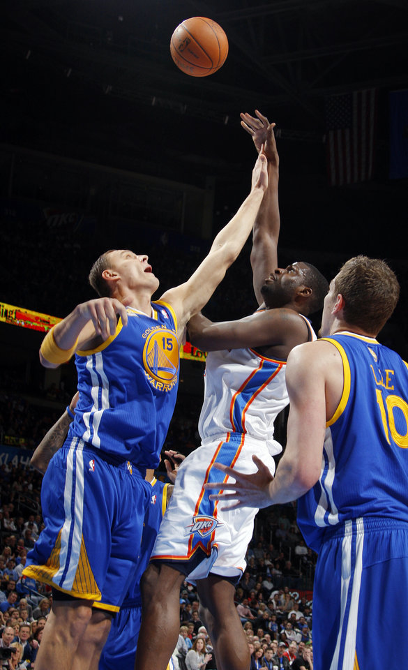 Photo - Oklahoma City's Nazr Mohammed (8) takes a shot between Golden State's Andris Biedrins (15), left, and David Lee (10) during the NBA basketball game between the Oklahoma City Thunder and the Golden State Warriors at the Chesapeake Energy Arena in Oklahoma City, Friday, Feb. 17, 2012. Photo by Nate Billings, The Oklahoman