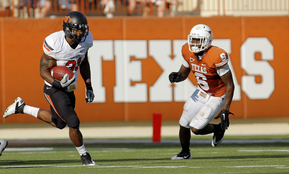 Photo - Oklahoma State's Jeremy Smith (31) gets past Texas' Christian Scott (6) on a long touchdown run in the third quarter during a college football game between the Oklahoma State University Cowboys (OSU) and the University of Texas Longhorns (UT) at Darrell K Royal-Texas Memorial Stadium in Austin, Texas, Saturday, Oct. 15, 2011. OSU won, 38-26. Photo by Nate Billings, The Oklahoman