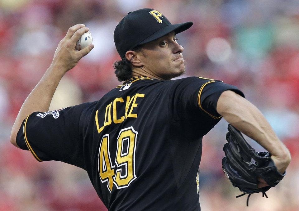 Photo - Pittsburgh Pirates starting pitcher Jeff Locke throws against the Cincinnati Reds in the first inning of a baseball game, Friday, July 11, 2014, in Cincinnati. (AP Photo/Al Behrman)