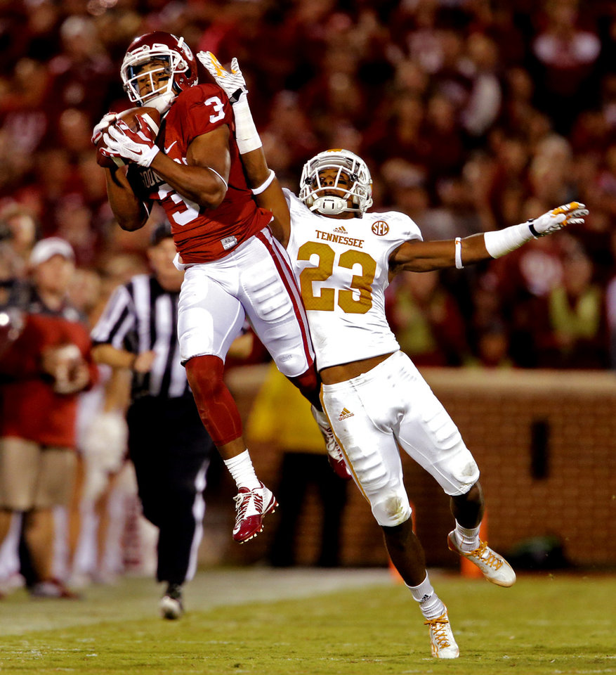 Photo - Oklahoma's Sterling Shepard (3) catches a pass in front of Tennessee's Cameron Sutton (23) during a college football game between the University of Oklahoma Sooners (OU) and the Tennessee Volunteers at Gaylord Family-Oklahoma Memorial Stadium in Norman, Okla., on Saturday, Sept. 13, 2014. Photo by Steve Sisney, The Oklahoman