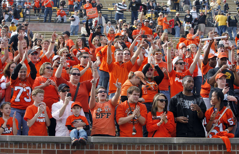 Photo - OSU fans celebrate the Cowboys win over Missouri during a college football game between the Oklahoma State University Cowboys (OSU) and the University of Missouri Tigers (Mizzou) at Faurot Field in Columbia, Mo., Saturday, Oct. 22, 2011. Photo by Sarah Phipps, The Oklahoman