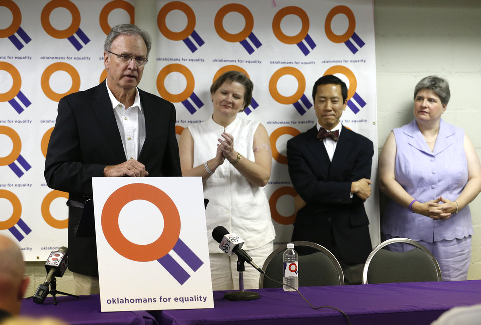 Photo - Attorney Don Holladay (left) takes part in a press conference with Mary Bishop, attorney Joe Thai and Sharon Baldwin (right) at the Dennis R. Neill Equality Center in Tulsa, Okla. on Monday, October 6, 2014. MATT BARNARD/Tulsa World