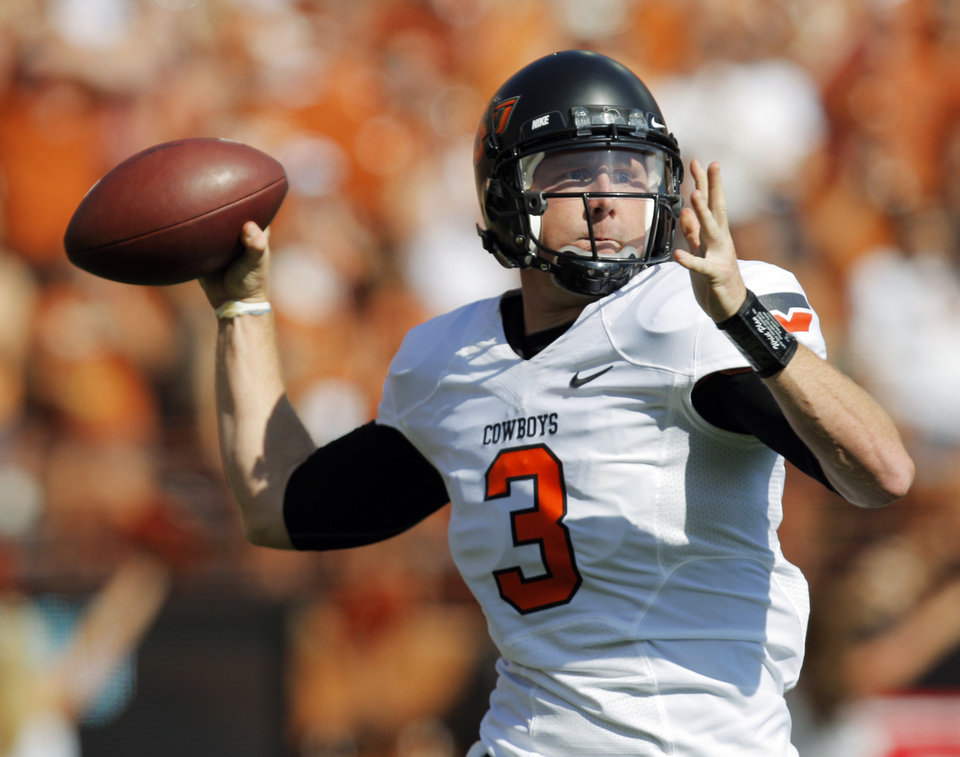 Photo - Oklahoma State's Brandon Weeden (3) passes the ball in the first half during a college football game between the Oklahoma State University Cowboys (OSU) and the University of Texas Longhorns (UT) at Darrell K Royal-Texas Memorial Stadium in Austin, Texas, Saturday, Oct. 15, 2011. Photo by Nate Billings, The Oklahoman