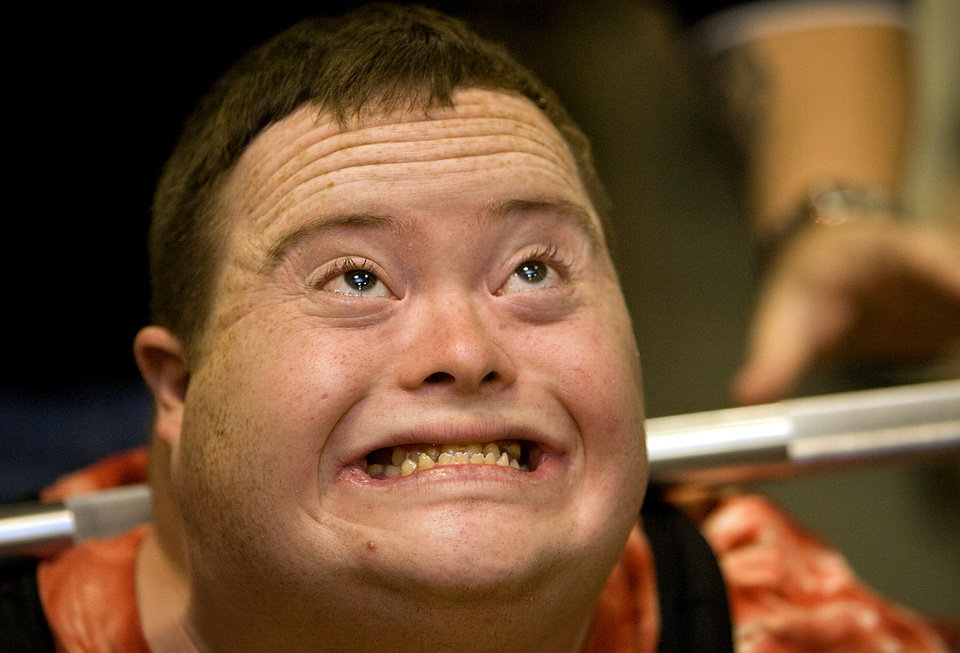 Ben Grubb stays focused as he lifts the weight for his squat attempt during the powerlifting competition for the Special Olympics at Oklahoma State University (OSU) on Wednesday, May 13, 2009, in Stillwater, Okla.   Photo by Chris Landsberger, The Oklahoman