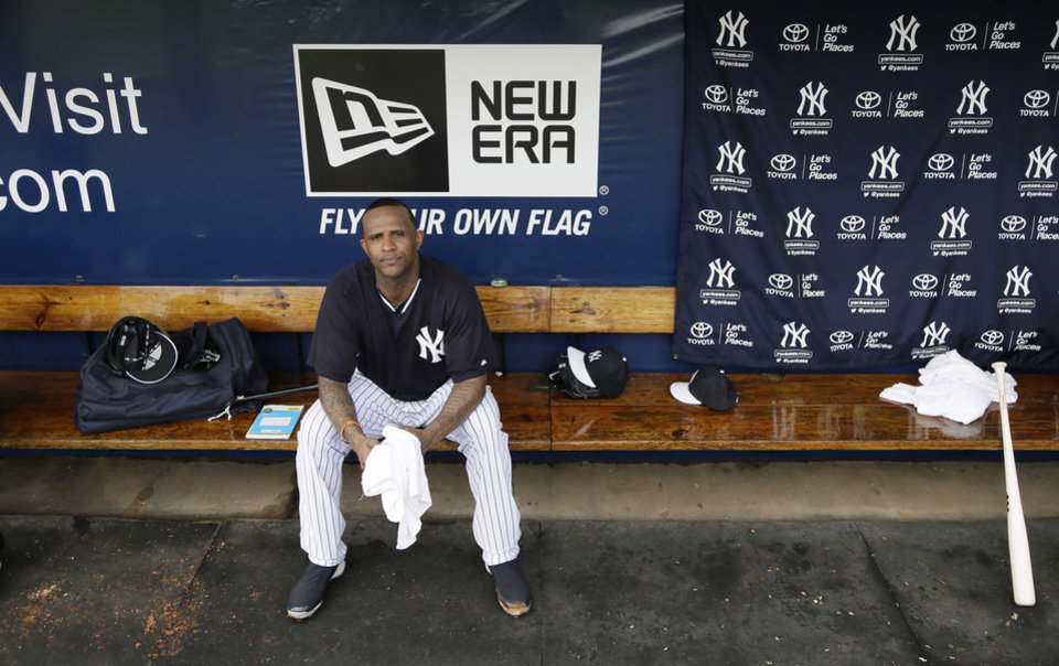 Photo - New York Yankees starting pitcher CC Sabathia sits in a dugout during spring training baseball practice Friday, Feb. 21, 2014, in Tampa, Fla. (AP Photo/Charlie Neibergall)
