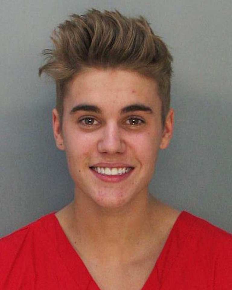 Photo - This police booking mug made available by the Miami Dade County Corrections Department shows pop star Justin Bieber, Thursday, Jan. 23, 2014. Bieber  and R7B singer Khalil were arrested for allegedly drag-racing on a Miami Beach Street. Police say Bieber has been charged with resisting arrest without violence in addition to drag racing and DUI. Police also say the singer told authorities he had consumed alcohol, smoked marijuana and taken prescription drugs. (AP Photo/Miami Dade County Jail)