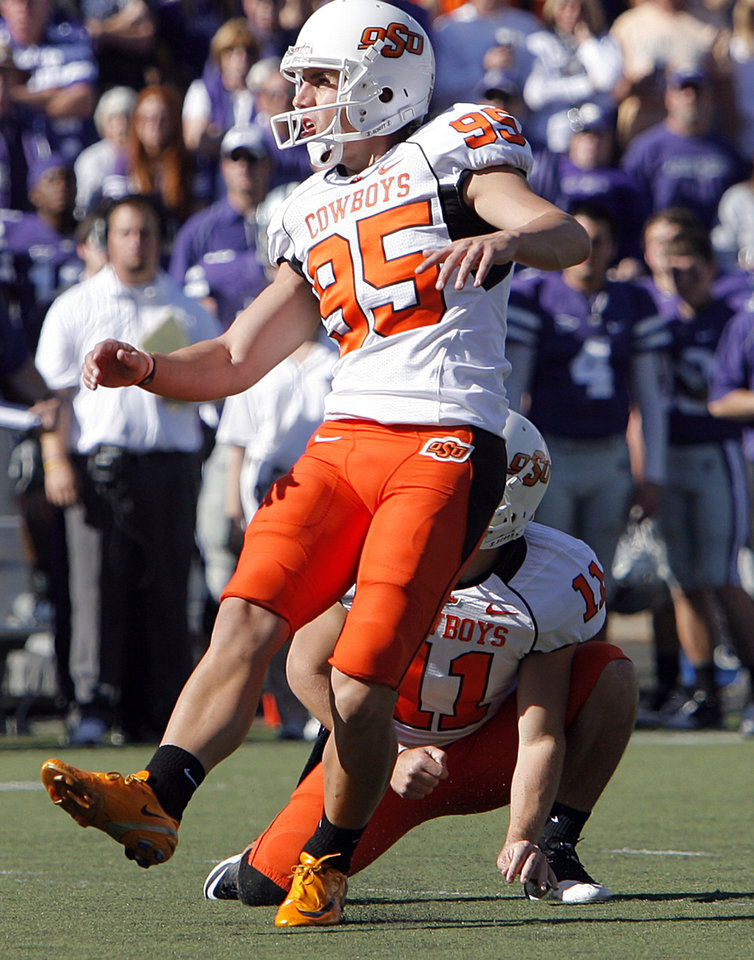 Photo - Oklahoma State's Dan Bailey (95) kicks a field goal during the second half of the college football game between the Oklahoma State University Cowboys (OSU) and the Kansas State University Wildcats (KSU) on Saturday, Oct. 30, 2010, in Manhattan, Kan.   Photo by Chris Landsberger, The Oklahoman