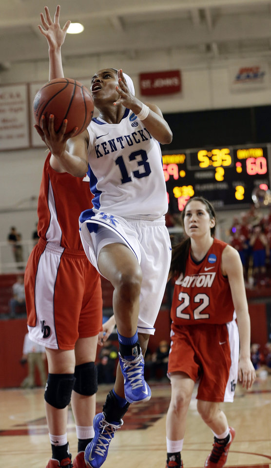 Photo - Kentucky's Bria Goss (13) drives past Dayton's Kelley Austria (22) and another defender in the second half of a second-round game in the NCAA women's college basketball tournament Tuesday, March 26, 2013, in New York. Kentucky won 84-70. (AP Photo/Frank Franklin)