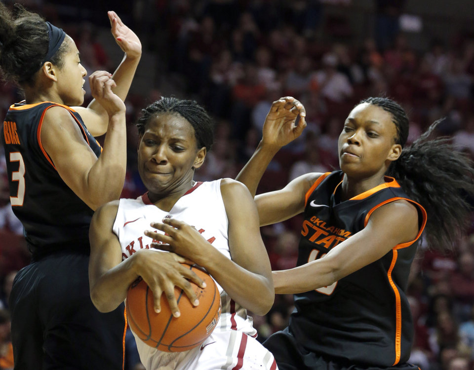 Oklahoma State's Tiffany Bias (3) and Toni Young (15) fight Sharane Campbell (24) for a rebound during the women's Bedlam basketball game between Oklahoma State University and Oklahoma at the Lloyd Noble Center in Norman, Okla., Sunday, Feb. 10, 2013.Photo by Sarah Phipps, The Oklahoman