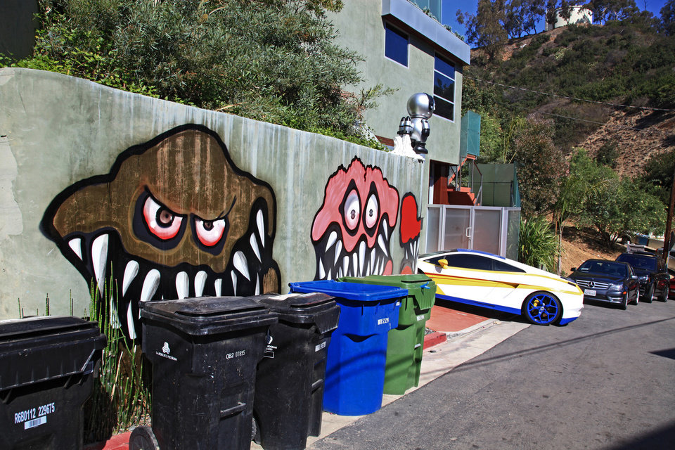 Photo - This Sunday May 12,2013 photo shows a mural painted on the outside of the Grammy-winning musician Chris Brown's neighbors are unhappy with what some are calling frightening art he's chosen to have painted along the curb of his Hollywood Hills home of Chris Brown in Los Angeles. The Grammy-winning musician's neighbors are unhappy with what some are calling frightening art he's chosen to have painted along the curb of his Hollywood Hills home. (AP Photo/Richard Vogel)