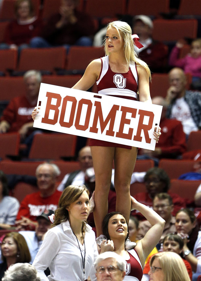 Photo - Cheerleaders encourage the crown in the second half as the University of Oklahoma Sooners (OU) defeat the Gonzaga Bulldogs 82-78 in NCAA, women's college basketball at The Lloyd Noble Center on Thursday, Nov. 14, 2013  in Norman, Okla. Photo by Steve Sisney, The Oklahoman
