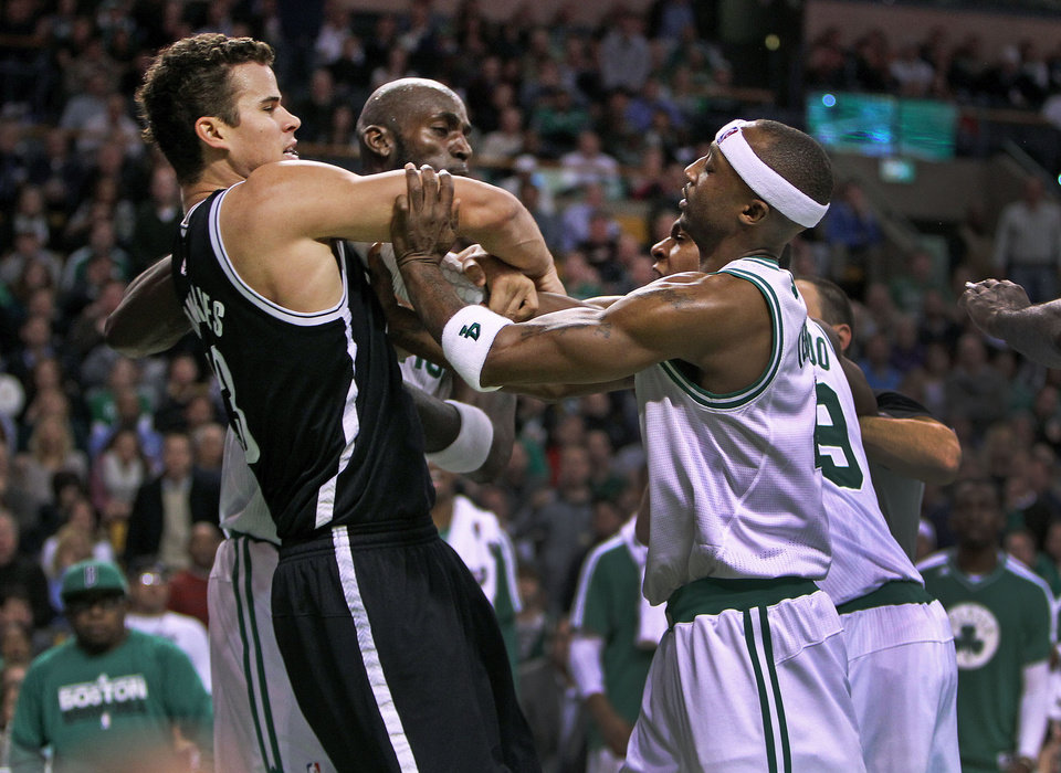 Photo - Boston Celtics' Kevin Garnett, center, Rajon Rondo, front right and Jason Terry (partially obscured, back right, confront Brooklyn Nets' Kris Humphries, front left, during an NBA game in Boston, Wednesday, Nov. 28, 2012. (AP Photo/The Globe/Jim Davis)  NO SALES; MAGAZINES OUT; INTERNET OUT; BOSTON HERALD OUT; QUINCY OUT