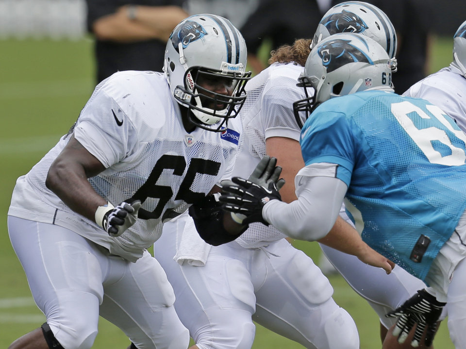 Carolina Panthers' Garry Williams (65) battles Kawann Short (68) during practice at NFL football training camp in Spartanburg, S.C., Thursday, Aug. 1, 2013. (AP Photo/Chuck Burton)