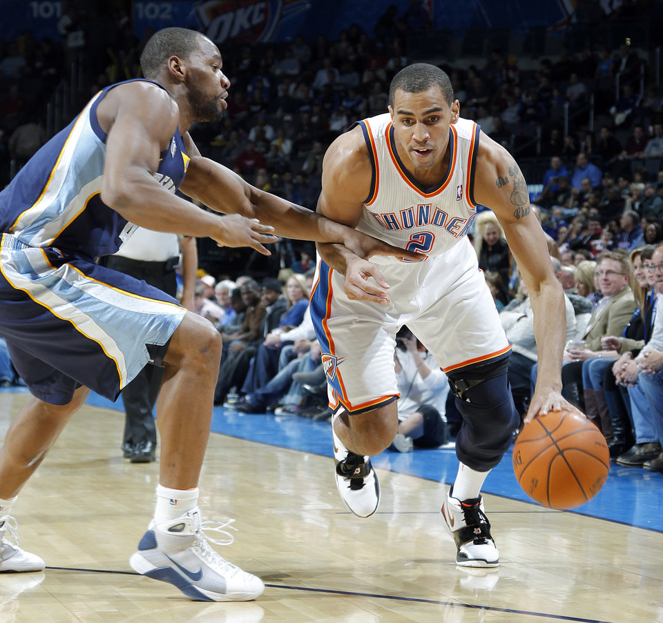 The Thunder's Thabo Sefolosha (2) drives the ball against Memphis' Sam Young (4) during the NBA basketball game between the Oklahoma City Thunder and the Memphis Grizzlies at the Oklahoma City Arena on Tuesday, Feb. 8, 2011, Oklahoma City, Okla.