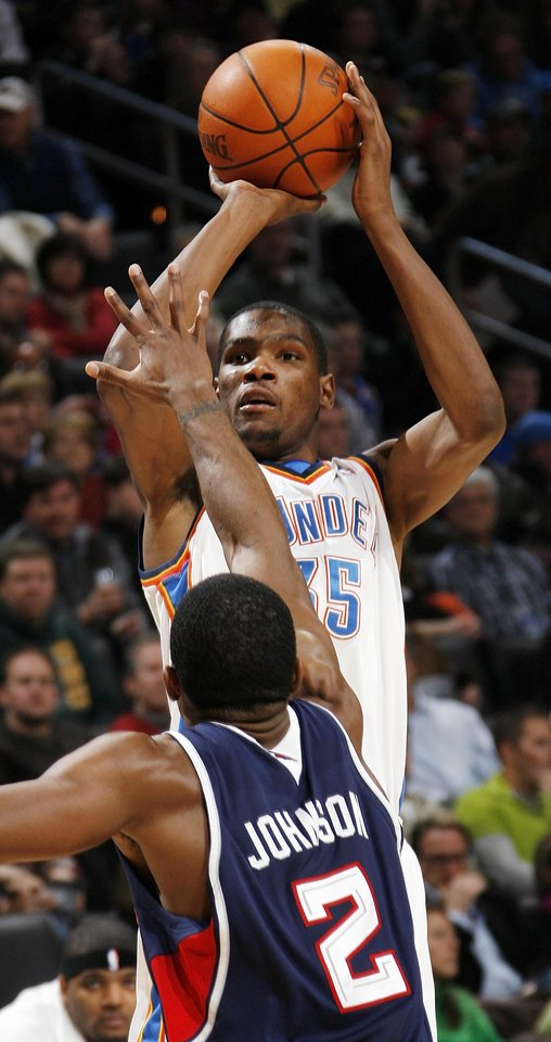 Kevin Durant (35) of Oklahoma City shoots over Joe Johnson (2) of Atlanta during the NBA basketball game between the Atlanta Hawks and the Oklahoma City Thunder at the Ford Center in Oklahoma City, Tuesday, February 2, 2010. The Thunder won, 106-99. Photo by Nate Billings, The Oklahoman
