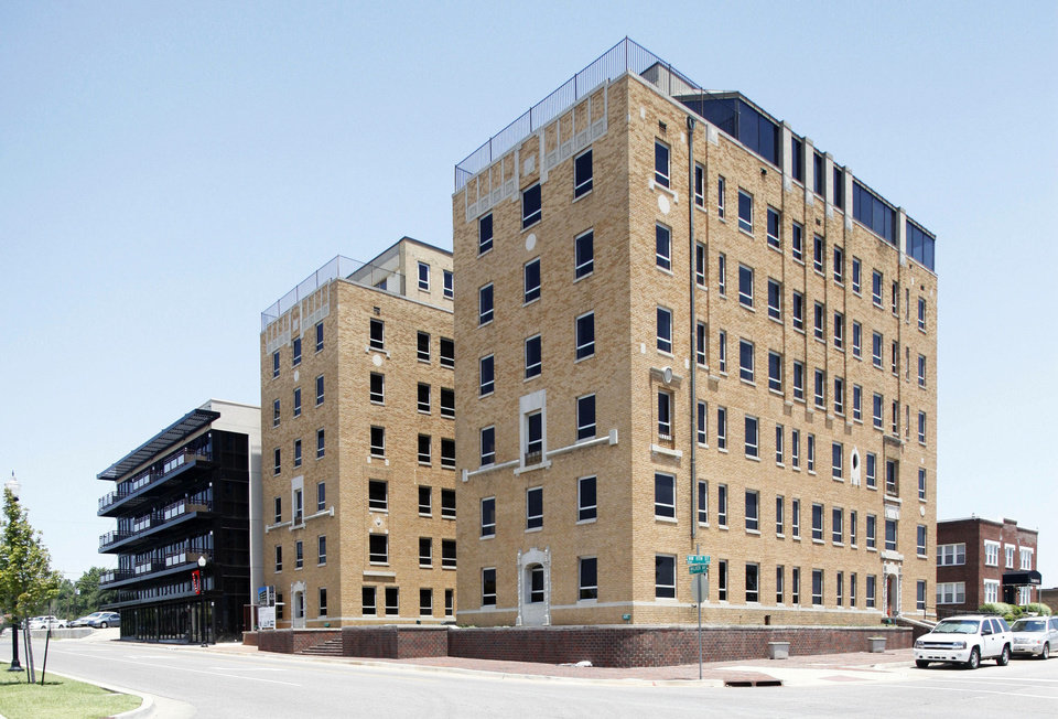 The Osler Building, 1200 N Walker Ave., right, is set to be converted into a 54-room Ambassador Hotel. The building to the left, the 1212 Building, was recently reopened as a mix of apartments and retail. Photo by PAUL HELLSTERN, The Oklahoman