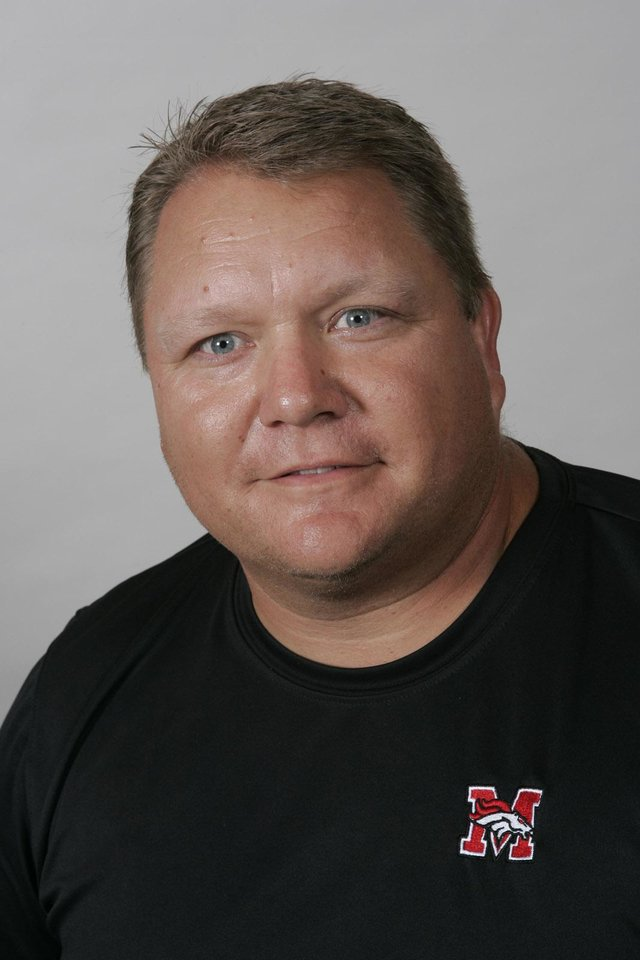 Photo - Former Mustang football coach Todd Dilbeck is expected to be named the football coach and athletic director at Choctaw. Staff photo by Doug Hoke.
