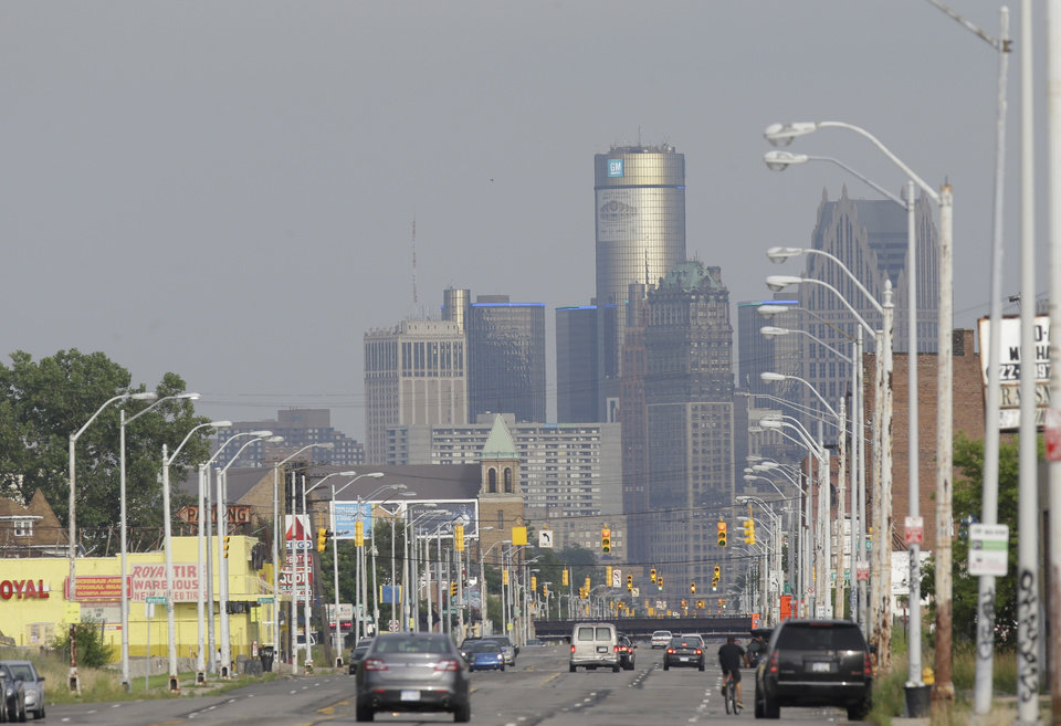 Photo - The Detroit skyline is seen from Grand River on Thursday, July 18, 2013, in Detroit. On Thursday the city became the largest city in U.S. history to file for bankruptcy when State-appointed emergency manager Kevyn Orr asked a federal judge for municipal bankruptcy protection. (AP Photo/Carlos Osorio)