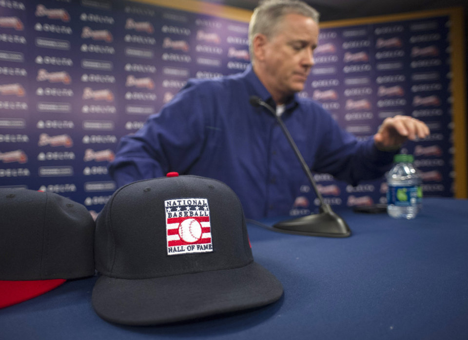 Photo - Former Atlanta Braves pitcher Tom Glavine gets up from a news conference at Turner Field on Wednesday, Jan. 8, 2014, in Atlanta. Glavine, former Braves teammate Greg Maddux and Frank Thomas were elected to baseball's Hall of Fame on Wednesday. (AP Photo/John Amis)