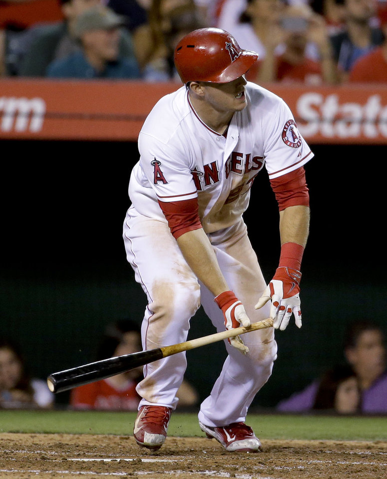 Photo - Los Angeles Angels' Mike Trout watches his RBI double against the Miami Marlins during the fourth inning of a baseball game in Anaheim, Calif., Tuesday, Aug. 26, 2014. (AP Photo/Chris Carlson)