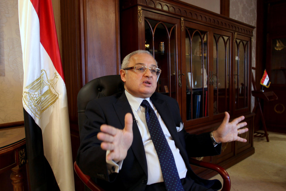 Photo - Egypt's minister of tourism, Hesham Zaazoua, speaks during an interview with the Associated Press at his office in Cairo, Egypt Thursday, March 28, 2013.  Egypt's tourism minister says Iranian tourists would help shore up Egypt's dilapidated tourism industry and would not pose security challenge to the nation. Zaazoua says he does not worry that visiting Iranians would try to export a revolution to Egypt. (AP Photo/Khalil Hamra)