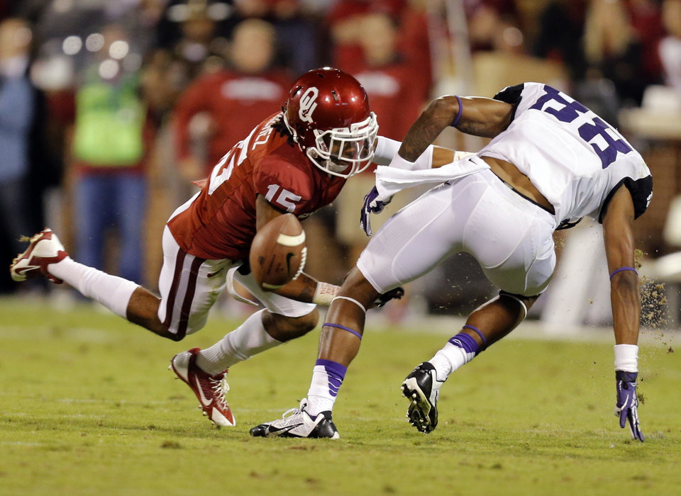Oklahoma\'s Zack Sanchez (15) breaks up a pass for TCU \'s Cam White (88) during the college football game between the University of Oklahoma Sooners (OU) and the Texas Christian University Horned Frogs (TCU) at the Gaylord Family-Oklahoma Memorial Stadium on Saturday, Oct. 5, 2013 in Norman, Okla. Photo by Chris Landsberger, The Oklahoman