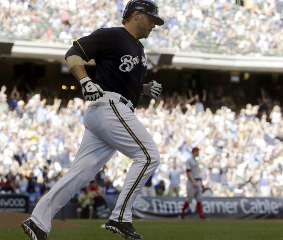 Photo - Milwaukee Brewers' Mark Reynolds rounds the bases after hitting a home run during the eighth inning of a baseball game against the Cincinnati Reds, Wednesday, July 23, 2014, in Milwaukee. (AP Photo/Morry Gash)