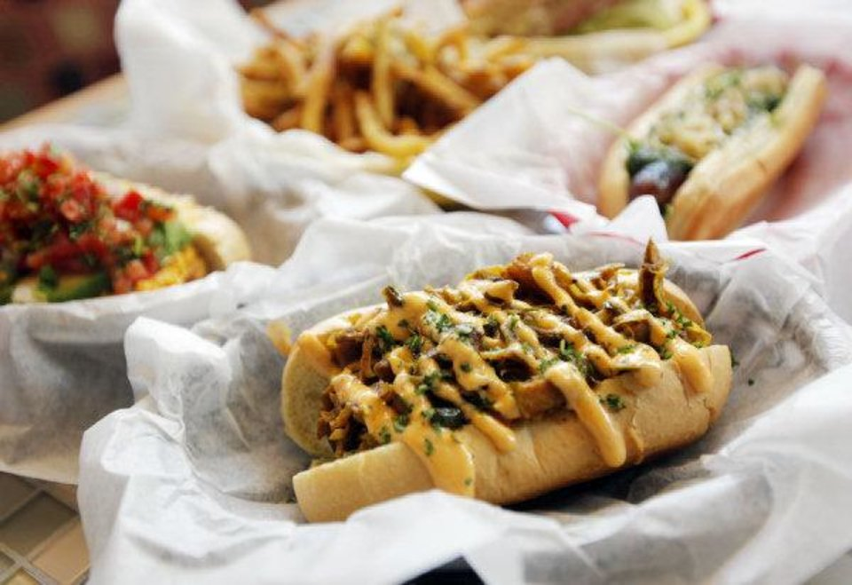 Photo - A Slum Dog with other menu items at Mutts Amazing Hot Dogs. Photo by Nate Billings, The Oklahoman  NATE BILLINGS