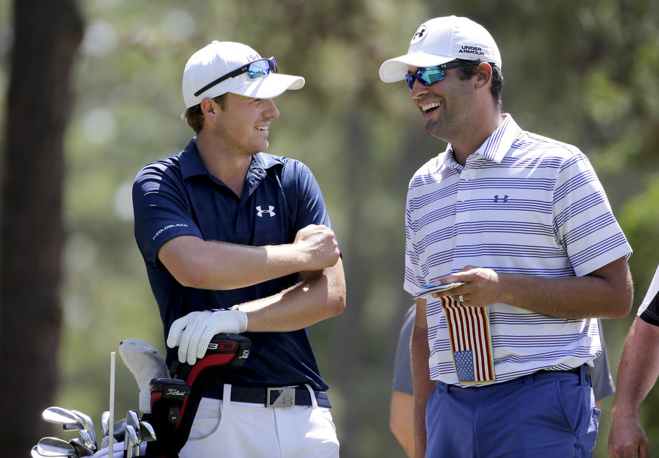Photo - Jordan Spieth, left,  and caddie Michael Greller talk on the 14th hole during a practice round for the U.S. Open golf tournament in Pinehurst, N.C., Tuesday, June 10, 2014. The tournament starts Thursday. (AP Photo/Chuck Burton)