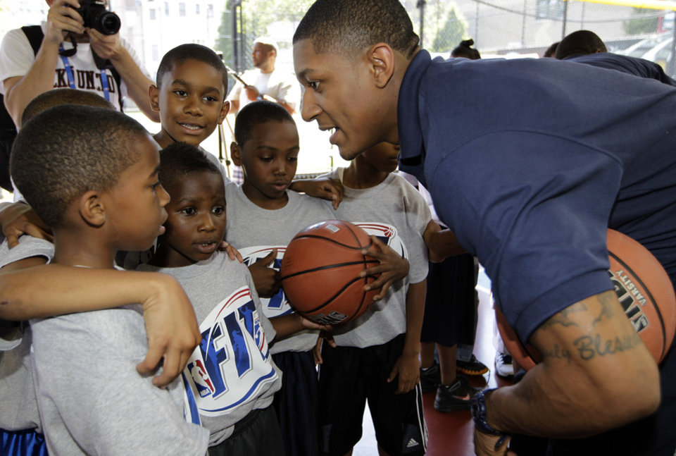 Photo - NBA Draft prospect Bradley Beal, right, talks to youngsters during an NBA fitness clinic at the Children's Aid Society Dunlevy Milbank Boys & Girls Club in the Harlem section of New York, Wednesday, June 27, 2012. (AP Photo/Kathy Willens)