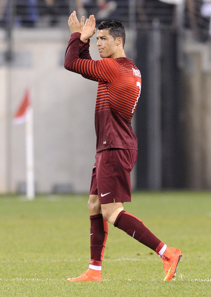 Photo - Portugal's Cristiano Ronaldo applauds the fans as he leaves the game during the second half of an international friendly soccer match against the Republic of Ireland Tuesday, June 10, 2014, in East Rutherford, N.J. Portugal won 5-1. (AP Photo/Bill Kostroun)