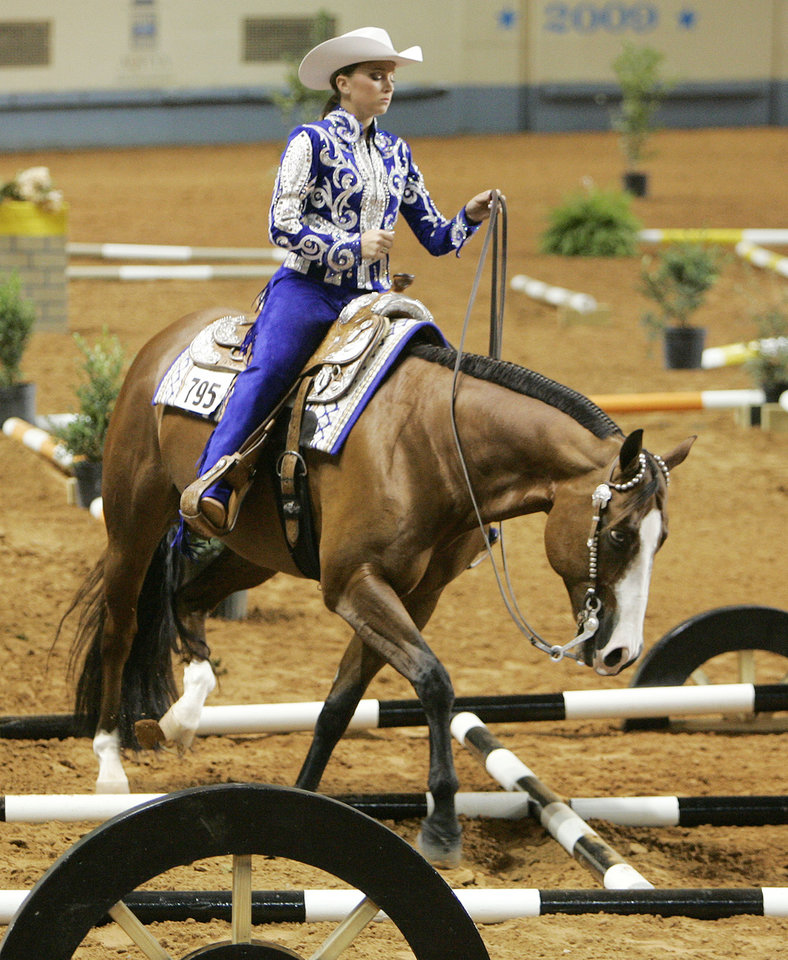 "Cassandra Mantor of Corpus Christi, Tx. rides ""Too Blue To Be True"" during an event at the quarter horse show at State Fair Park Wed. Aug. 5, 2009 in OKC. Photo by Jaconna Aguirre,The Oklahoman"