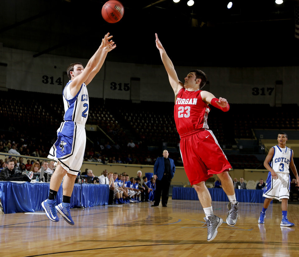Photo - Coyle's Ryan Weathers shoots a basket over Forgan's Chandler Bryer during a Class B Boys game of the state high school basketball tournament between Forgan and Coyle at the State Fair Arena at State Fair Park in Oklahoma City, Thursday, Feb. 28, 2013. Photo by Bryan Terry, The Oklahoman