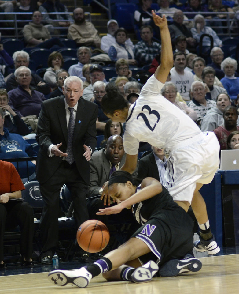 Photo - Penn State's Ariel Edwards (23) reaches for possession of a loose ball around  Northwestern's Lauren Douglas as Northwestern's head coach Joe McKeown looks on, during the first half of an NCAA basketball game in State College, Pa., Thursday, Feb. 20, 2014. (AP Photo/Ralph Wilson)
