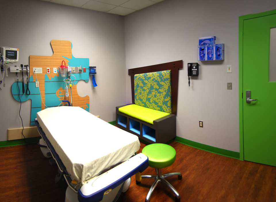 Photo - Bright colors give energy to an emergency examination room at The Children's Hospital, in a design by Kara McDonald of Miles Associates.   - PROVIDED BY MILES ASSOCIATES