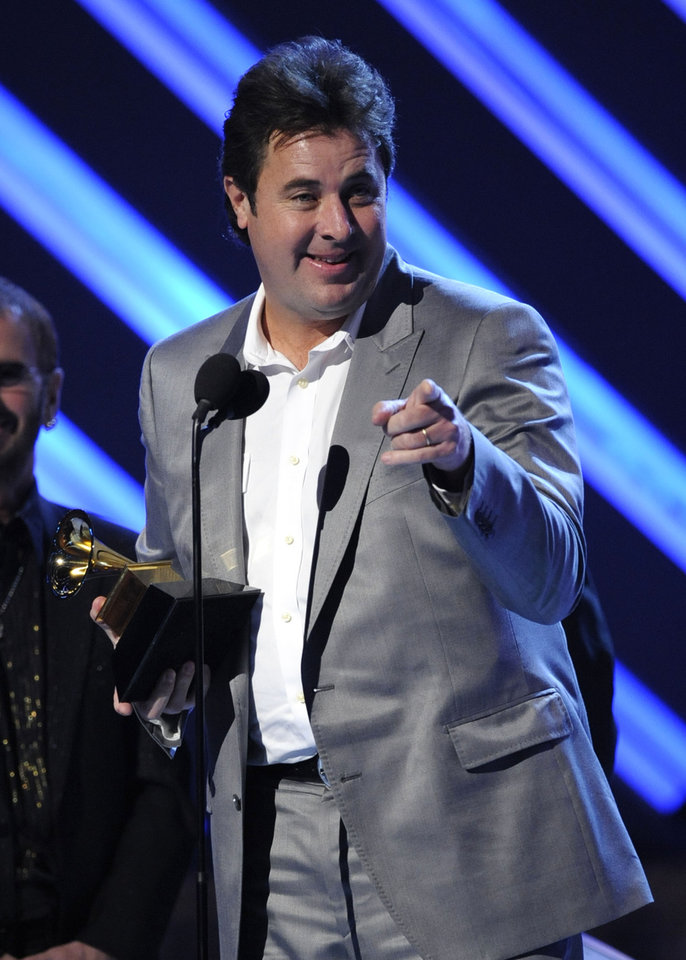 Photo - Vince Gill accepts the award for best country album for These Days at the 50th Annual Grammy Awards on Sunday, Feb. 10, 2008, in Los Angeles.  (AP Photo/Kevork Djansezian) ORG XMIT: CADC202