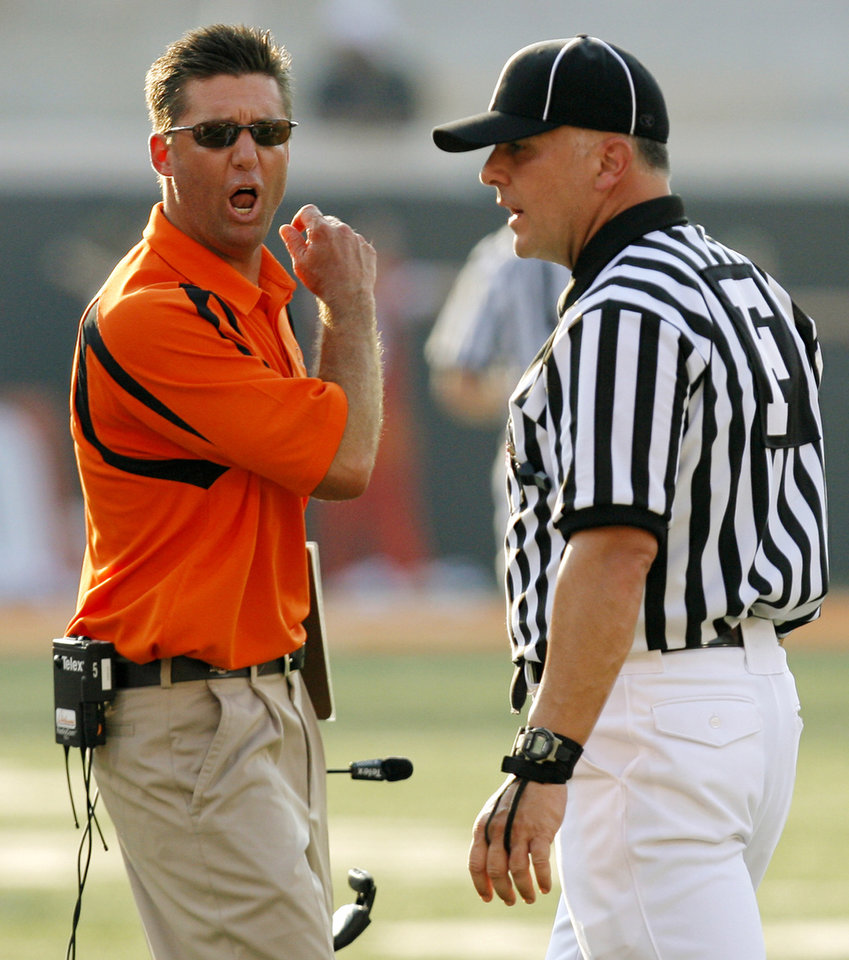 Photo - OSU head coach Mike Gundy yells at an official during the second half of the college football game between the Oklahoma State University Cowboys (OSU) and the Texas Tech University Red Raiders (TTU) at Boone Pickens Stadium in Stillwater, Okla., on Saturday, Sept. 22, 2007. OSU won, 49-45. By NATE BILLINGS, The Oklahoman